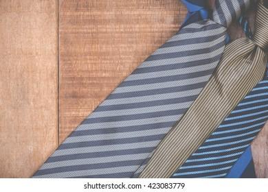 Necktie on grunge wood background