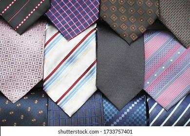 Neckties. Set different neckties. Colored tie for men. Set of stylish men accessories, men's fashion. Collection of coiled neckties in display. Sakura necktie. Bow tie.