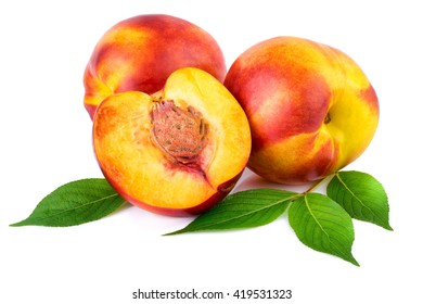 Nectarine organic fruits with leaves on white background.