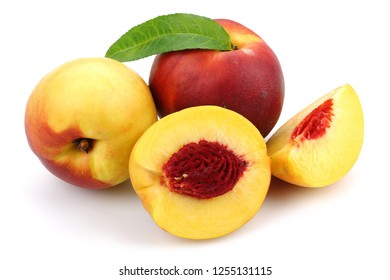 Nectarine peaches with leaf isolated on white background