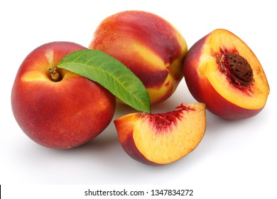 Nectarine peaches with slice and leaf isolated on white background