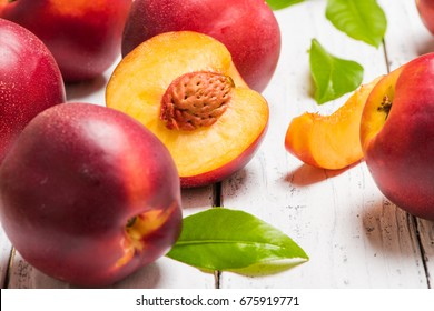 Nectarines on a light wooden background