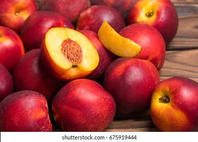 Nectarines on a wooden board