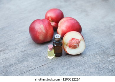 nectarines seeds kernel essential oil bottle with ripe red nectarines