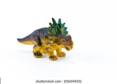 Nedoceratops funny toy mini macro dinosaur isolated in white background
