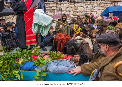 NEDOUSA GREECE - FEB 2018: The funeral of the groom in a cheerful social gathering with comic and humorous moments during Nedousa folk carnival event.