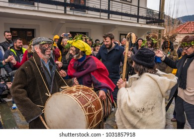 NEDOUSA, GREECE - FEBRUARY 2018: Tourists and visitors dancing at the main square of Nedousa village during the folk local carnival of Nedousa in Messenia, Greece