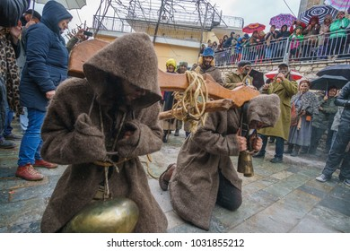 NEDOUSA, GREECE - FEBRUARY 2018: Villagers pull a plough through the village at the folk local carnival of Nedousa village in Messenia, Greece