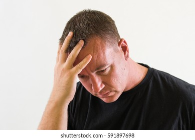 Nee image of a handsome man, embarrassed or in thought.