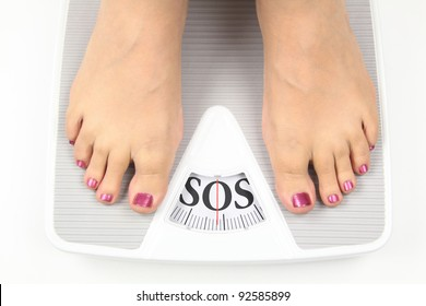 Need diet. Woman on scale