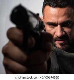 Need for revenge. Close up gun barrel. Killer or murderer concept. Head hunting. Man handsome mafia killer going to shot someone. Finish him. Kill them all. Final shot. Concentrate on gun shot.