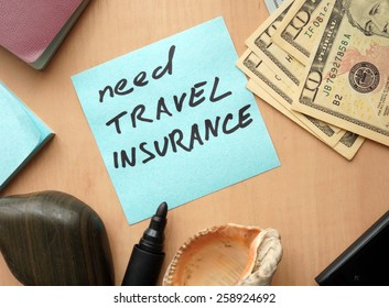 Need travel insurance paper on a table with money