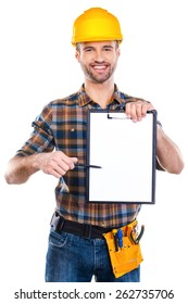 I need your signature here. Cheerful young male carpenter holding clipboard and pointing it with pen while standing against white background