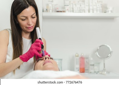 Needle mesotherapy . Cosmetics been injected woman's face. Space for text on grey background.