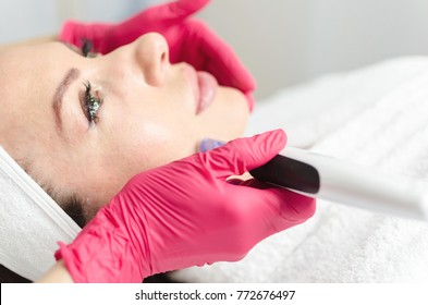 Needle mesotherapy. Microneedle meso therapy, treatment woman at the beautician spa salon. Space for text. Fresh and clean skin face.