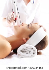 Needle mesotherapy.Beautician performs a needle mesotherapy treatment on a woman's face