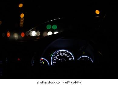 Needle miles car at night.