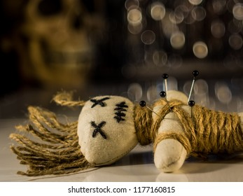 a needle punched doll lies on a table