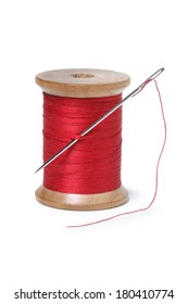 needle and red thread on white