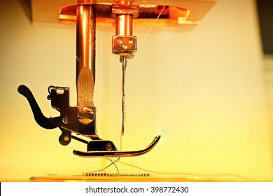 Needle and thread of an electric sewing machine. Vintage colored.