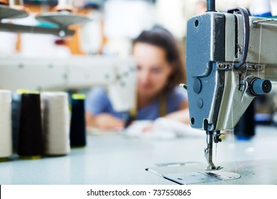 Needle with thread in professional sewing machine on factory, closeup view
