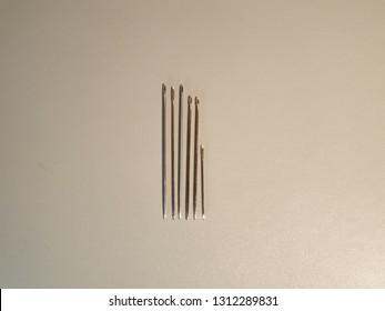 Needles close up. Metal needles. Sewing needles.