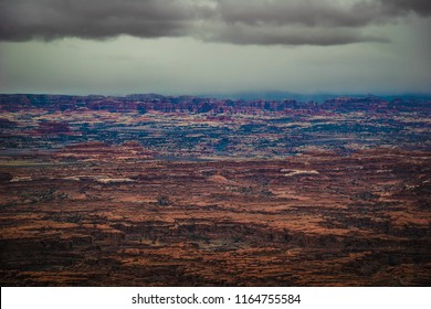 The Needles formations can clearly be seen in this panoramic view at the Needles Overlook in the Canyon Roms Recreational Area near Monticello, Utah. Storm skies presently surround this overlook.
