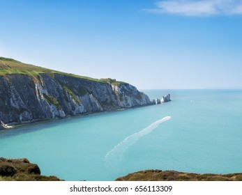 The Needles - is a row of three distinctive stacks of chalk that rise out of the sea off the western extremity of the Isle of Wight, UK, close to Alum Bay.