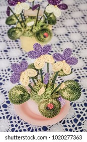 needlework flowers on shelf to sell