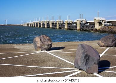Neeltje jans Delta bridge behind coast stones