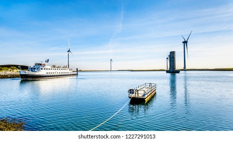 Neeltje Jans, Zeeland/the Netherlands - Sept 17, 2018: Tourist Boat at the Delta Works Storm Surge Barrier at the Oosterschelde departing from Neeltje Jans island in Zeeand Province in the Netherlands