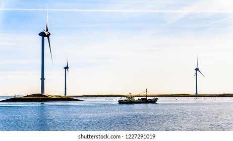 Neeltje Jans, Zeeland/the Netherlands - Sept 17, 2018: Fishing Boat and Wind Turbines at the Oosterschelde inlet at the Neeltje Jans island at the Delta Works Storm Surge Barrier