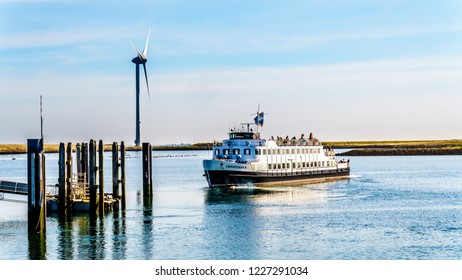 Neeltje Jans, Zeeland/the Netherlands - Sept 17, 2018: Tourist Boat at the Delta Works Storm Surge Barrier at the Oosterschelde departing from Neeltje Jans island in Zeeand Province in the Netherlands