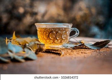 Neem tea with leaves on a wooden surface is Immune Boosting - Neem leaf tea is a good immune boosting agent that works well to keep away cardiovascular disease, strokes, and cancer.