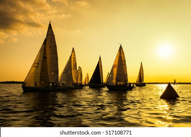 Neenah, WI - 2 August 2016:  Sailboats race in a seasonal race held every Tuessday evening during the summer