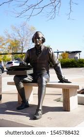 Neenah, Wisconsin / USA - October 27th, 2019: Thomas Jefferson landmark statue signing declaration of the Independence of the Public Art in Neenah, Wisconsin