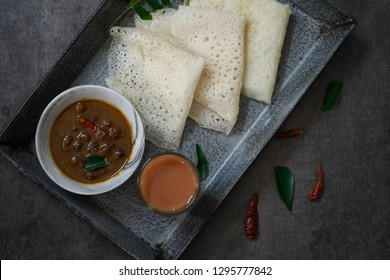 Neer Dosa / South Indian rice Crepes with channa curry tea served in a tray