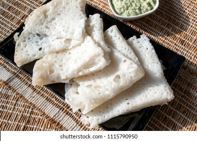 Neer dosa is a thin, fluffy and lacy crepes made with rice batter and served with coconut chutney.