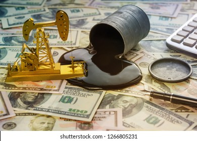 neftekachka, a barrel of oil on the background of banknotes of us dollars the oil market. sale of oil and petroleum products.