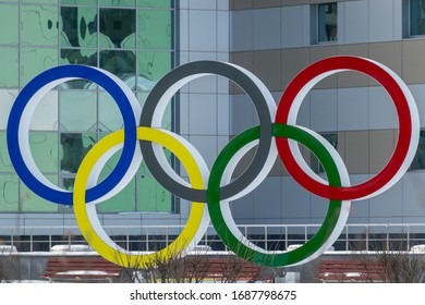 Nefteyugansk, Russia, March 9, 2020: Olympic rings on the background of the facade of the sports complex building.