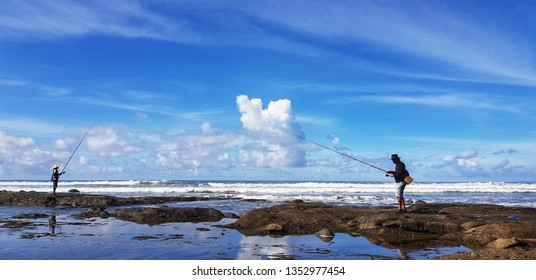Negara, Bali, Indonesia - October 16th 2018 : fishermans try to bid their luck in the early morning while the wave not to strong yet.