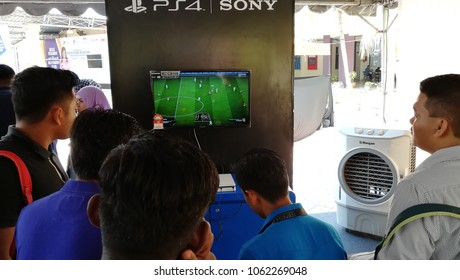 Negeri Sembilan, Malaysia - April 5,2018: Community Collage student playing Play Station after classes at Jelebu, Negeri Sembilan .PlayStation is a popular gaming brand