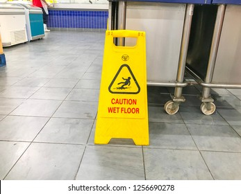 Negeri Sembilan, Malaysia - December 09, 2018; Slippery floor surface warning sign and symbol in building, hall, office, hotel , restaurant, restroom. Concept photo danger.