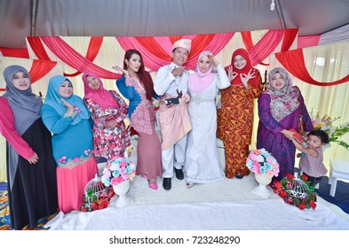 Negeri Sembilan, Malaysia - July 28,2017: Happy moment of bride and groom on their malay wedding. Bride and groom wearing traditional malay dressing