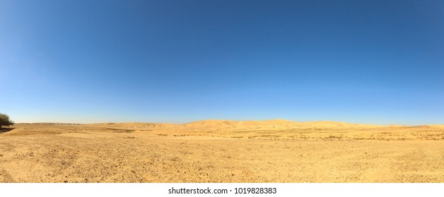 Negev Desert under blue sky
