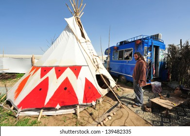 NEGEV,ISR - FEB 15:Man live in Tipi on February 15 2011.Painted  plains Indians tipis were mainly featured geometric portrayals of celestial bodies, war battles and animal designs.