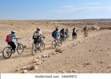 NEGEV,ISR - MAY 31 2009:Israeli people cycle in the Negev Desert.Various peoples have lived in the Negev since the dawn of history such as:Nomads, Canaanites, Nabateans and Israelis.