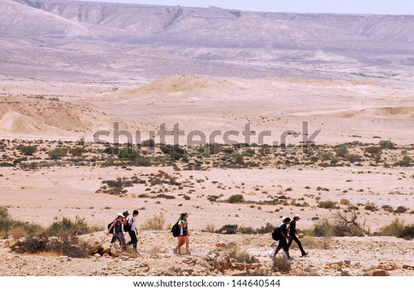 NEGEV,ISR - MAY 31:People cross the wilderness of the Negev Desert on May 31 2009.Various peoples have lived in the Negev since the dawn of history such as:Nomads, Canaanites, Nabateans and Israelis.
