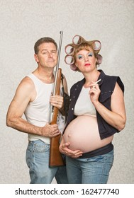 Negligent pregnant hillbilly couple with rifle and cigarettes