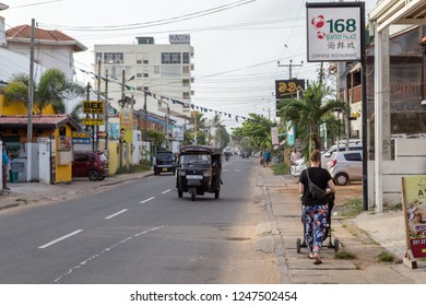 Negombo, Sri Lanka - July 22, 2018: People on the main road in the tourist area north of the ciry centre